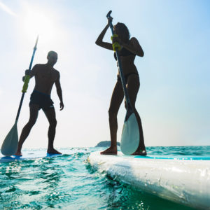 Holissence, paddleboarding, Young caucasian couple, Thailand beach on summer holidays, vacation travel,